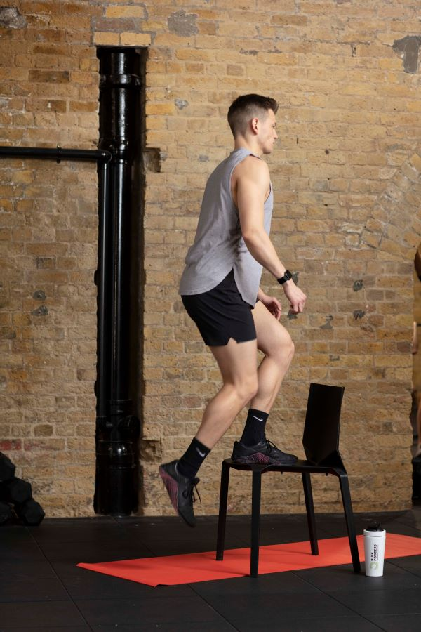 chair step-up with knee raise step 2