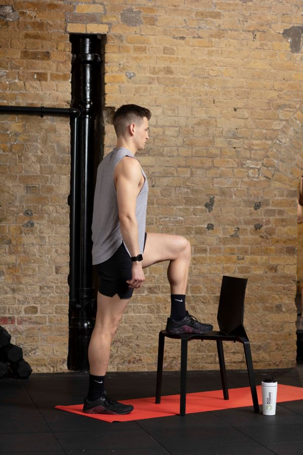 step-up with knee raise step 1